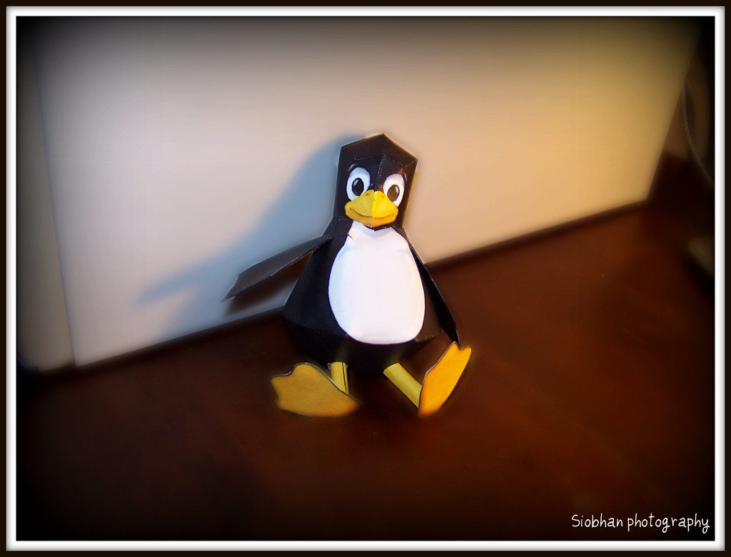 A small Tux the Penguin paper toy